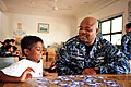 US Navy 110906-N-TO930-100 Chief Cryptologic Technician (Technical) Leon Jordan, from Chicago, plays cards with Philip Logeswa during a community s.jpg