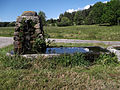 Un Lavoir en pierres situé au hameau de Daniecq.jpg