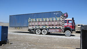 Standard forty-foot shipping container lying u...