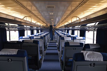The interior of the upper level of Superliner I coach No. 34960. This coach was rebuilt in the 2000s for use in California service and has expanded seating. Upper Level of Superliner I.jpg