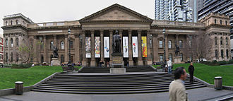 State Library of Victoria - A panoramic view of the library facade, forecourt and lawns from Swanston Street