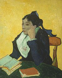 A well-dressed woman sits facing to her right (the viewer's left). She has two books on her lap, and is dressed in dark clothes vividly contrasted against a yellow background.