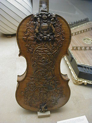 History of the violin - An intricately carved 17th century (circa 1660) British Royal Family violin, on display in the Victoria and Albert Museum in London.