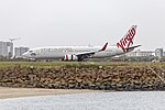 Virgin Australia (VH-VUQ) Boeing 737-8FE(WL) taxiing at Sydney Airport.jpg