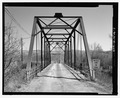 West portal; view to east - Garrison Bridge, Spanning Clark Fork River at Sawmill Road, Garrison, Powell County, MT HAER MT-116-7.tif