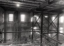 Inside of a building being renovated, with scaffolding