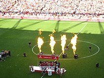 A coloured photograph of the Arsenal players celebrating their first Emirates Cup win.