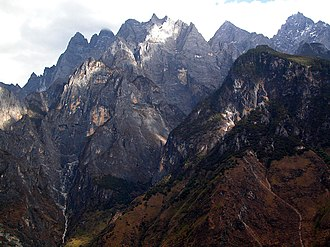 Yangtze - Afternoon light on the jagged grey mountains rising from the Yangtze River gorge