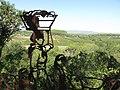 016 Escultura El marge dels oficis, de Luis Zafrilla (Castellet), al fons els camps de la Timba.jpg