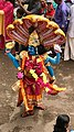 1st day procession with costumed Vishnu with Chakra and Conch at the Hindu festival Onam in Kerala.jpg