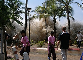 2004 Indian Ocean earthquake and tsunami - Tsunami washing ashore in Ao Nang, Thailand