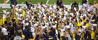 2008 Michigan Wolverines football team - Players and coaches celebrate with the Little Brown Jug after their victory