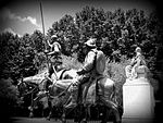 A Black and White Photo of the Bronze sculptures of Don Quixote and Sancho Panza in Madrid Spain.jpeg