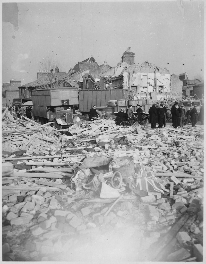 A British Flag lies among the rubble of homes smashed by the Camberwell Road Rocket explosion. V-bomb damage, London... - NARA - 540067.tif
