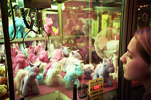 Claw crane - A claw crane game machine with pony plushes in Trouville, France