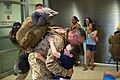 A U.S. Sailor, left foreground, with Explosive Ordnance Disposal Group 2 is greeted by his family upon returning to Norfolk, Va., June 1, 2013, after a 12-month deployment to Afghanistan in support of Combined 130601-N-AP176-078.jpg