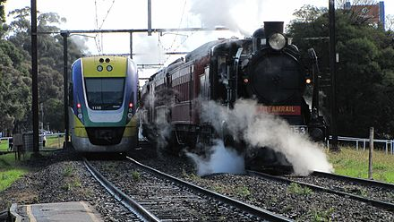 VLocity heads to Melbourne passes K153 heads to Pakenham with K190 in 25 April 2010 A VLine trains passes a steam locomotive at Pakenham.jpg