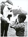A little Tokelauan boy with Santa Claus, 1966 (2).jpg