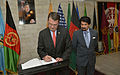 Afghan Deputy Minister of Defense Zaher Azimi, right, watches as Deputy Secretary of Defense Ashton B. Carter signs the guestbook at the Afghanistan Ministry of Defense in Kabul, Afghanistan 130914-D-NI589-1653.jpg