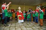 Airmen help Santa deliver gifts to special needs school 141208-F-OP138-017.jpg