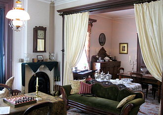 Bell Homestead National Historic Site - A portion of Melville House's parlour, restored to the Victorian era style maintained by the Bells, using many of their original furnishings and artifacts, including their melodeon, seen in front of the window at centre (2009).