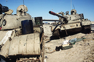 Highway of Death - Two Iraqi T-54/55 tanks lie abandoned near Kuwait City on February 26, 1991