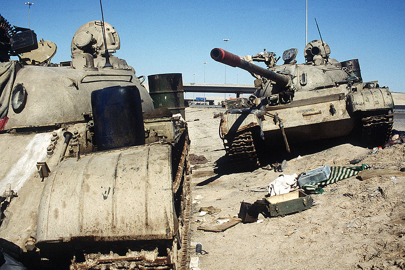 File:An Iraqi T-54, T-55 or Type 59 and T-55A on Basra-Kuwait Highway near Kuwait.JPEG