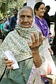 An old woman voter showing mark of indelible ink after casting her vote, at a polling booth, during the 2nd phase of Gujarat Assembly Election, in Gandhinagar, Gujarat on December 14, 2017.jpg