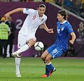 Andy Carroll and Riccardo Montolivo England-Italy Euro 2012.jpg
