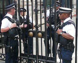 Metropolitan Police Service - Armed DPG police officers. Downing Street gates, 2014