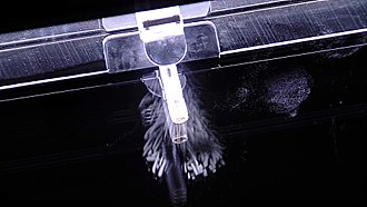 Radionuclide - Artificial nuclide americium-241 emitting alpha particles inserted into a cloud chamber for visualisation