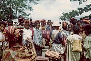 "Kemak people - A typical traditional clothing called ""tais"" as seen in a market in Atsabe, circa 1968-1970."