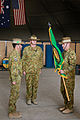 Australian Army Col. Wade Stothart, right, the commander of Combined Team Uruzgan, accepts the unit's flag from Maj. Gen. Gus McLachlan, center, the deputy chief of staff for plans of the International Security 130807-O-MD709-130-AU.jpg