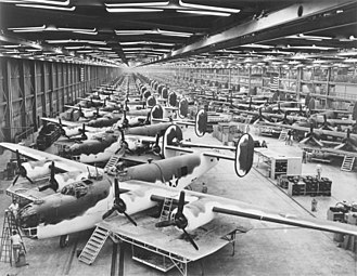 "Consolidated B-24 Liberator - AAF Antisubmarine Command (AAFAC) modifications at the Consolidated-Vultee Plant, Fort Worth, Texas in the foreground in the olive drab and white paint scheme. To the rear of this front line are partly assembled C-87 ""Liberator Express Transports""."
