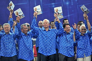 Barisan Nasional - High-ranking BN party officials holding copies of the party manifesto at a pre-election rally in 2013. In the front row, from left, are Chua Soi Lek (MCA), Muhyiddin Yassin, Najib Razak and Tengku Adnan Tengku Mansor (UMNO), and Abdul Taib Mahmud (PBB).
