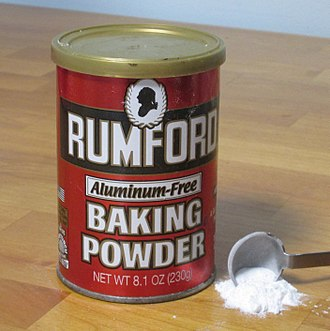 Baking powder - U.S. consumer-packaged baking powder. This particular type of baking powder contains monocalcium phosphate, sodium bicarbonate, and cornstarch.