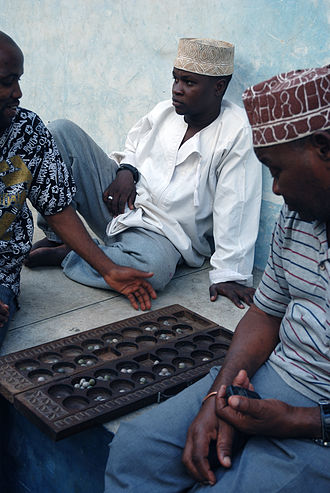 Mancala - Bao players in Zanzibar