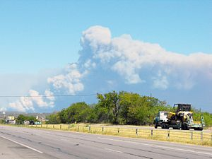 Bastrop County Complex Fire - Smoke from the wildfire rising over Texas State Highway 71 near Bastrop on September 5, 2011.