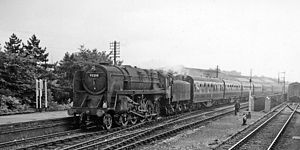 BR Standard Class 9F - A 9F hauling a passenger express at Bath Green Park station in 1962