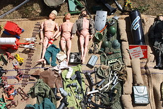 Action figure - Action figures, some stripped of their clothing and accessories