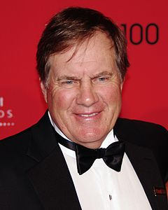 Color head-and-shoulders photograph of Bill Belichick wearing a black tuxedo and black tie.