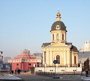 Arbat Street - Arbat Square. Right: The chapel of Boris and Gleb, built 1997. Left: The entrance Arbatskaya Metro Station.