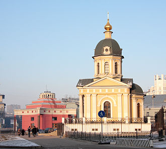 Arbat Street - Arbat Square. Right: The chapel of Boris and Gleb, built 1997. Left: The entrance Arbatskaya Metro Station.