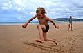 Boy's longjump at beach(14845923272).jpg
