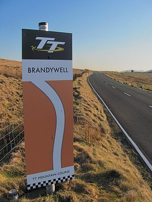 Brandywell, Isle of Man - Isle of Man TT Mountain course road-sign on A18 Snaefell Mountain Road, looking south-west towards  Beinn-y-Phott mountain