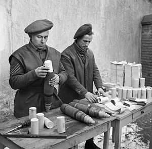 Ayrshire (Earl of Carrick's Own) Yeomanry - Gunners of 124 Battery, 151st Field Regiment load propaganda leaflets into shells, Holland 24 January 1945 (IWM B 14123)