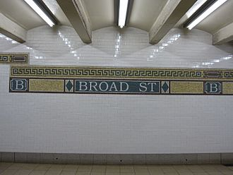 Broad Street (BMT Nassau Street Line) - Grecian revival tablet and frieze circa 1996 from original Vickers design