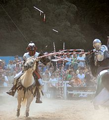 Broken lances are common in full contact jousts. In this picture, airborne fragments of both lances are visible.