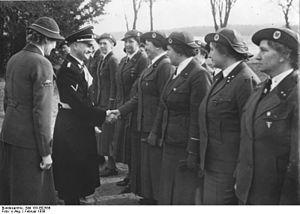 Ernst-Robert Grawitz - Grawitz greeting members of the National Leader's School of the German Red Cross, February, 1939