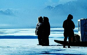 Sirmilik National Park - Inuit on the sea ice in front of Bylot Island